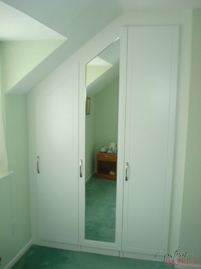 White doors with angled ceiling