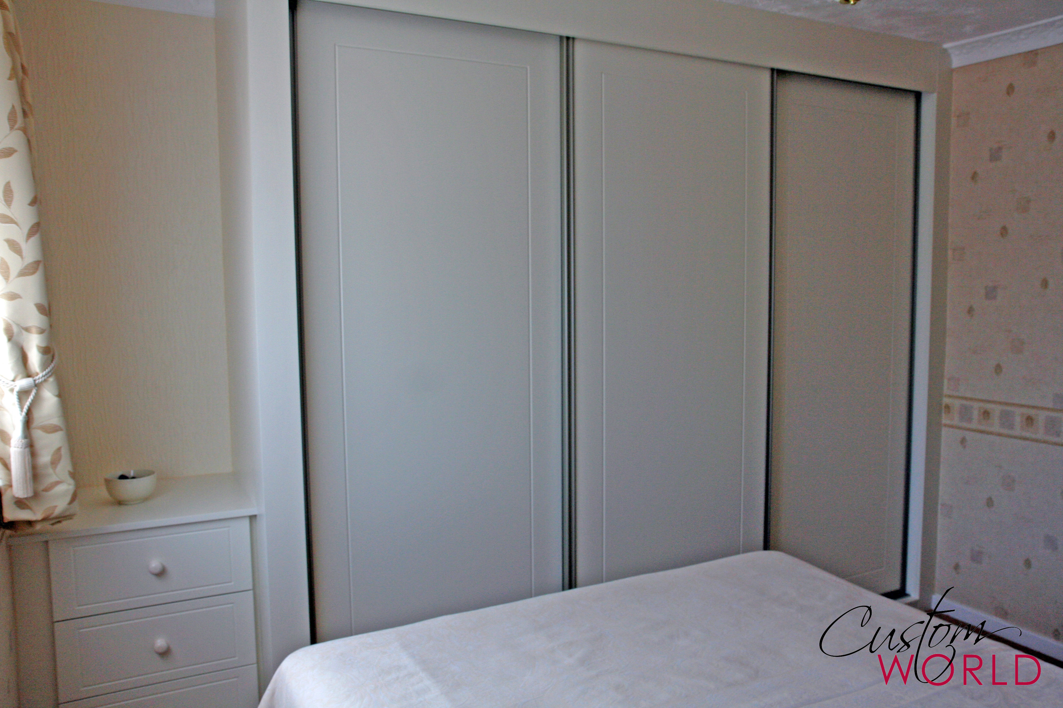 3 door sliding wardrobe with white frame and doors