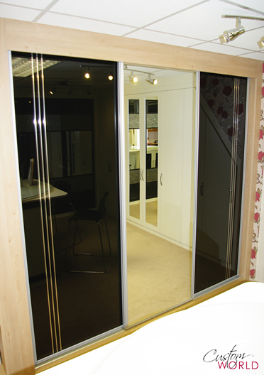Mirror and black glass sliding wardrobe