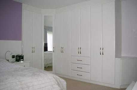 Bedroom furniture fitted bedrooms wardrobes from custom for Bedroom with attached bathroom designs