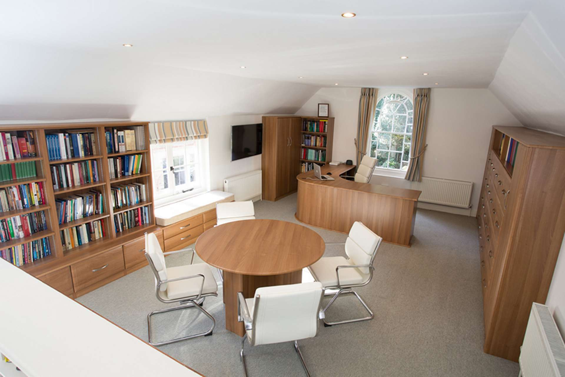 Full office fitted furniture with desk and meeting table
