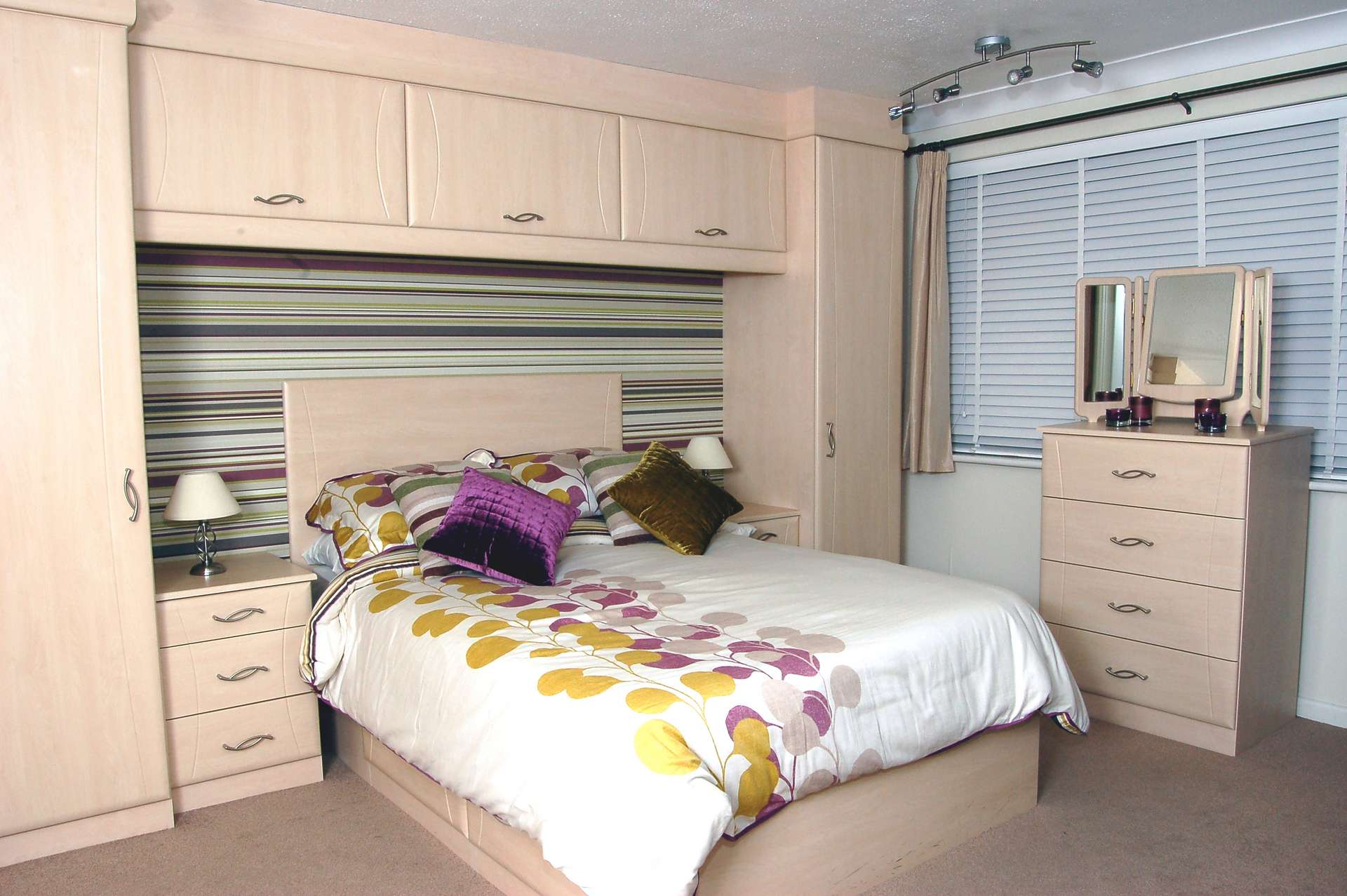 Custom made bed with wardrobes and overhead cupboards