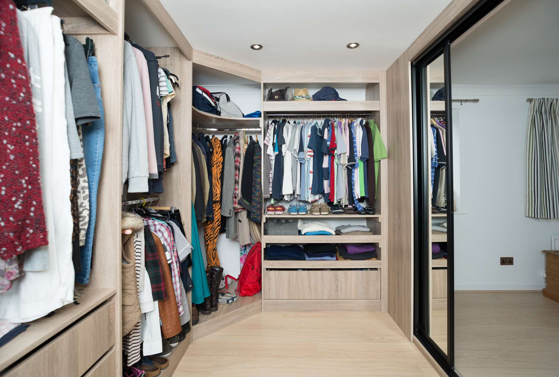 Sliding Door Walk in Wardrobe - Internal view with clothes