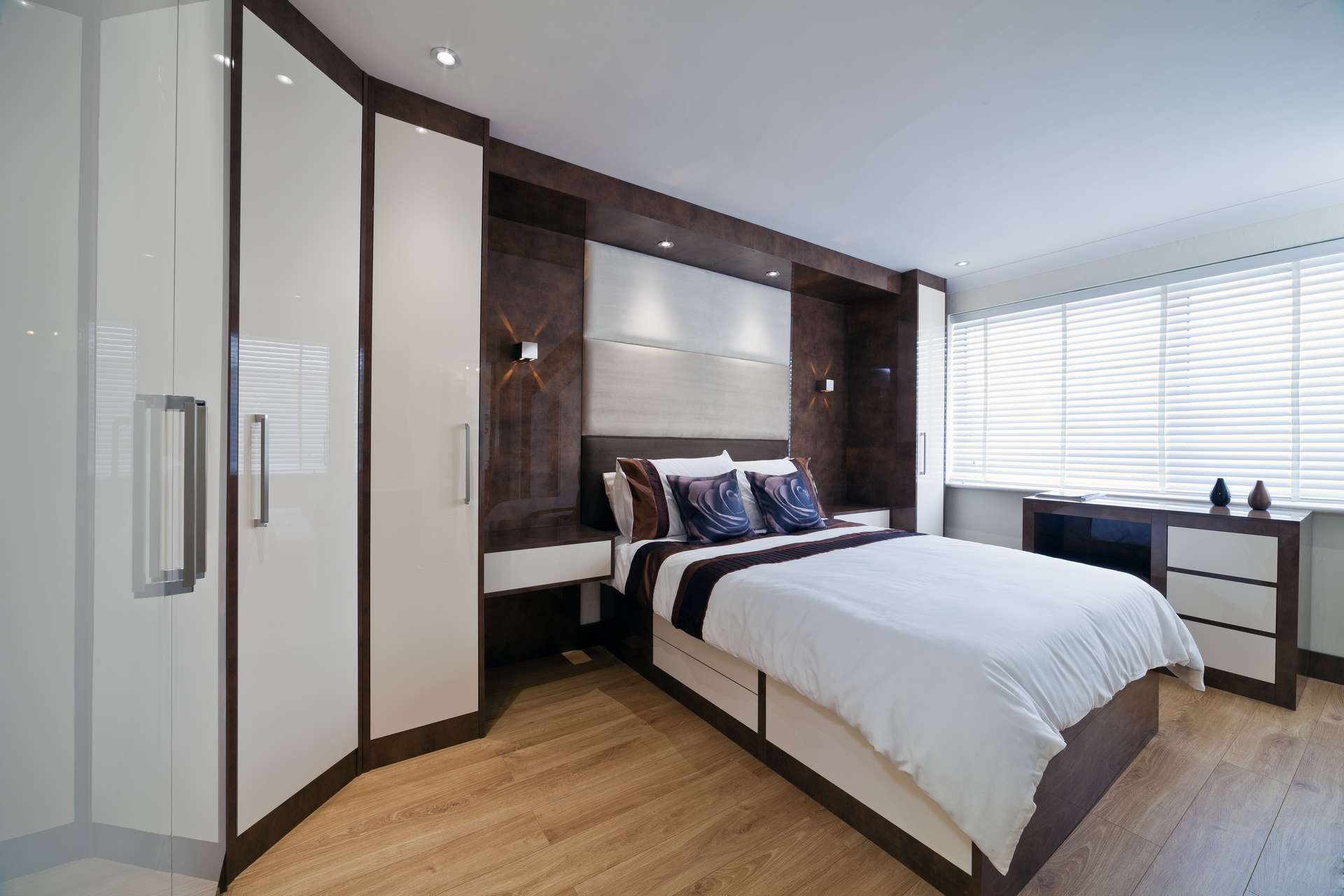 Modern design bed in high gloss lacquered finish with hinged door wardrobes