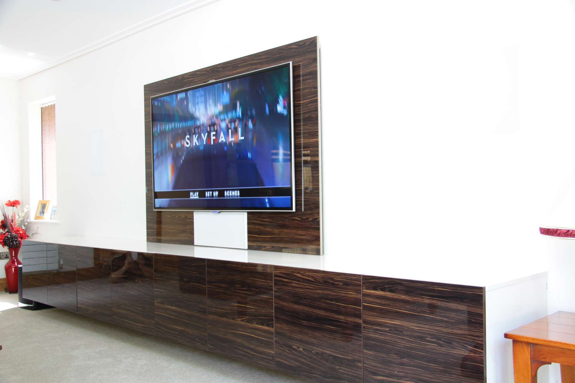 Wall mounted TV with floating media storage