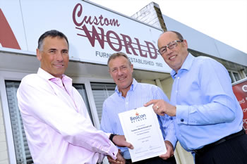 Custom World furniture manufacturers presented with certificate by Stephen and David of the Beacon Network