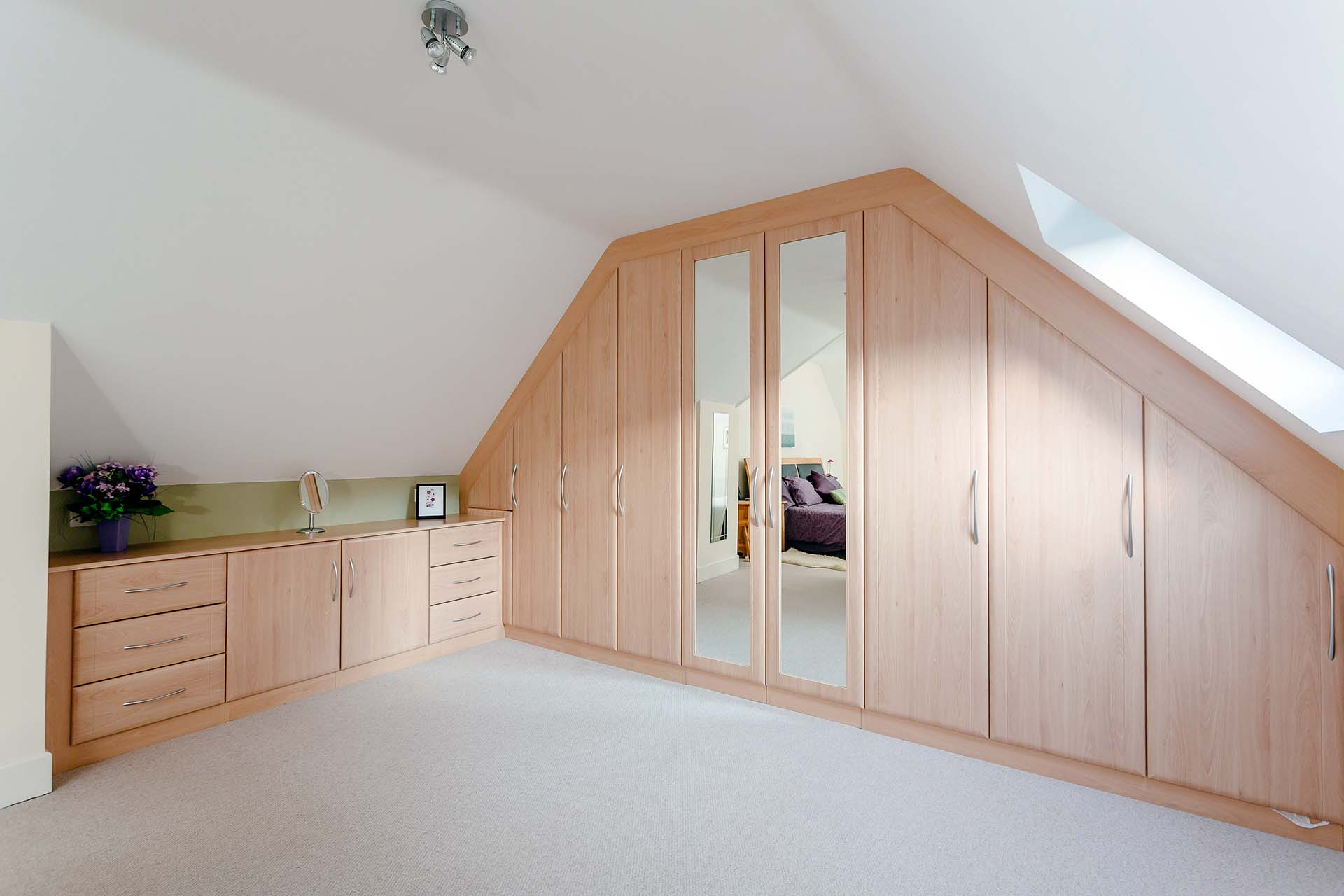 Fitted wardrobes from wall to wall sloping ceiling fitted in Ferndown