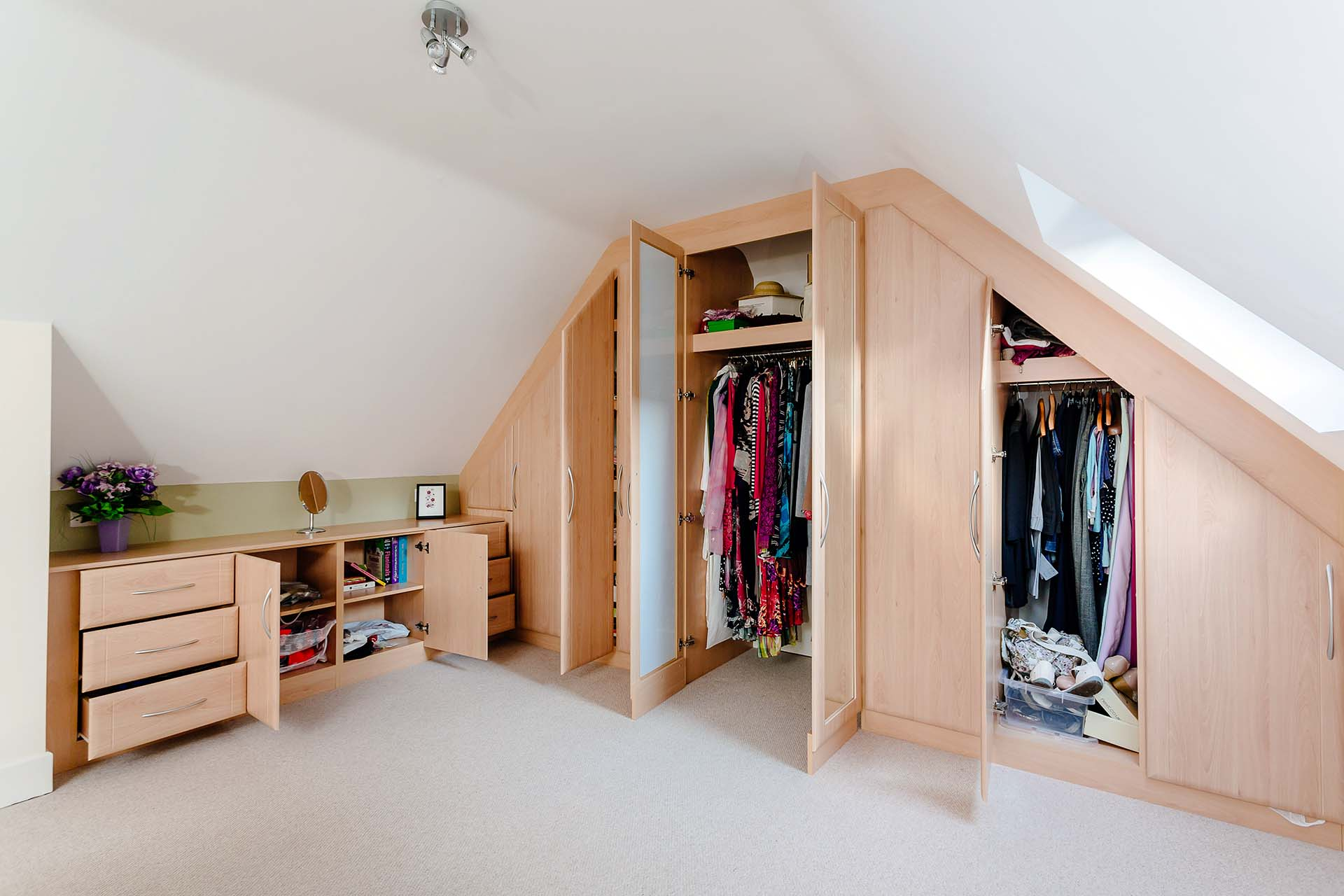 Hinged doors fully opened with generous storage room