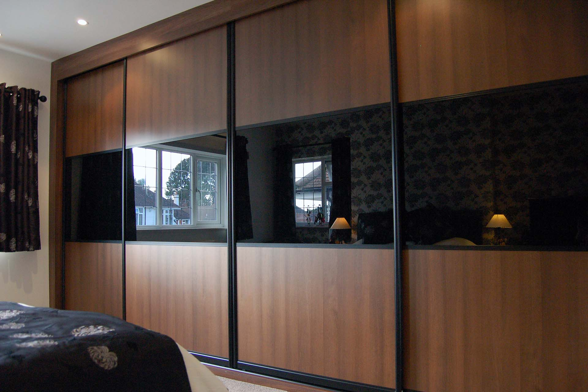 Dark wood finish combined with black glass with split bars sliding doors
