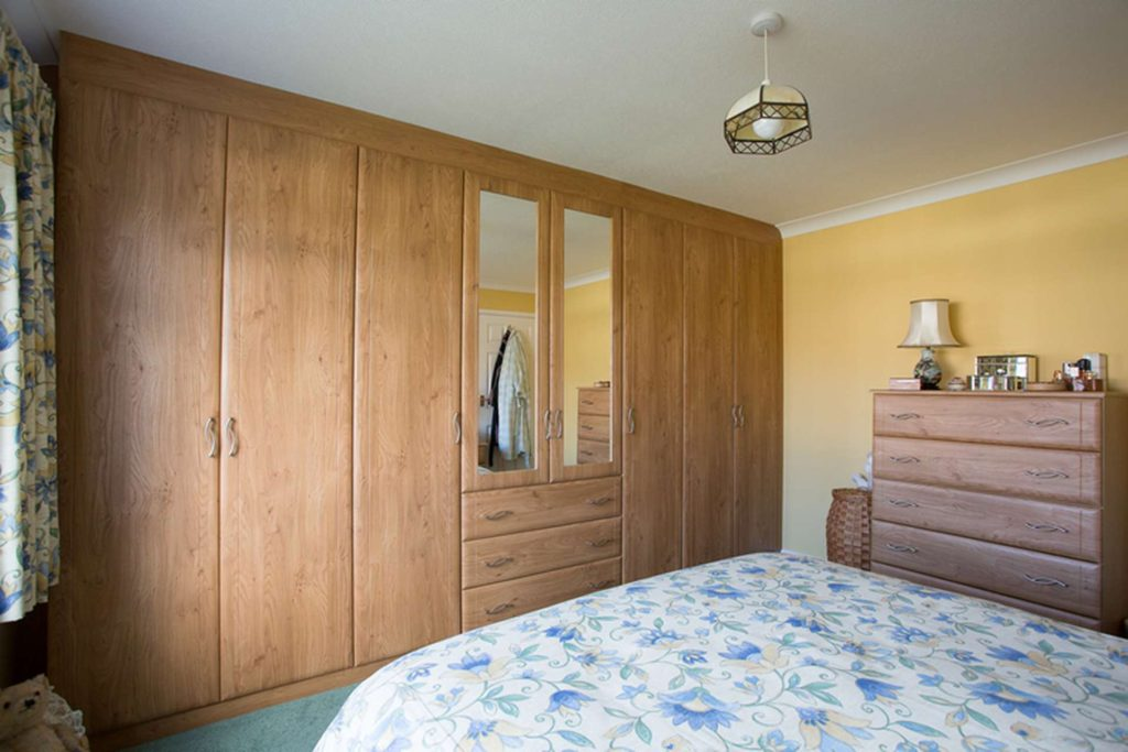 Hinged door wardrobes with mirror doors inset