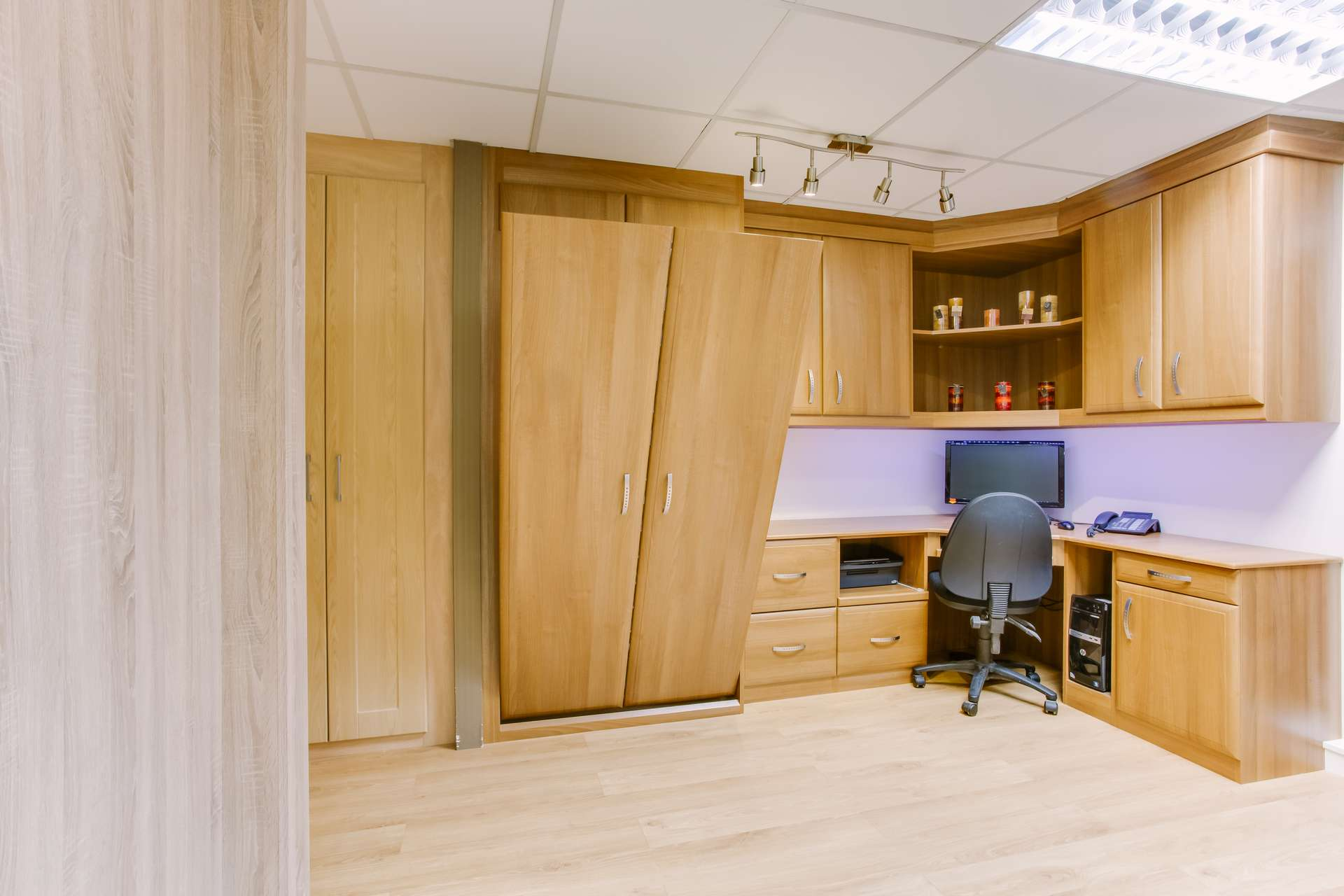 Combine a foldaway bed with a home office to make best use of space