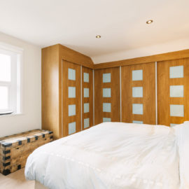Sliding Door Wardrobes with 5 doors in woodgrain