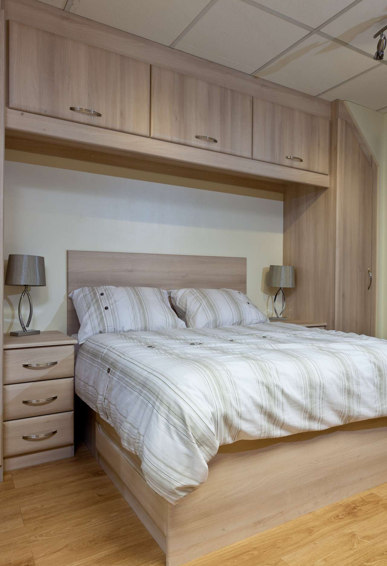 Traditional custom made bed with storage with cupboards