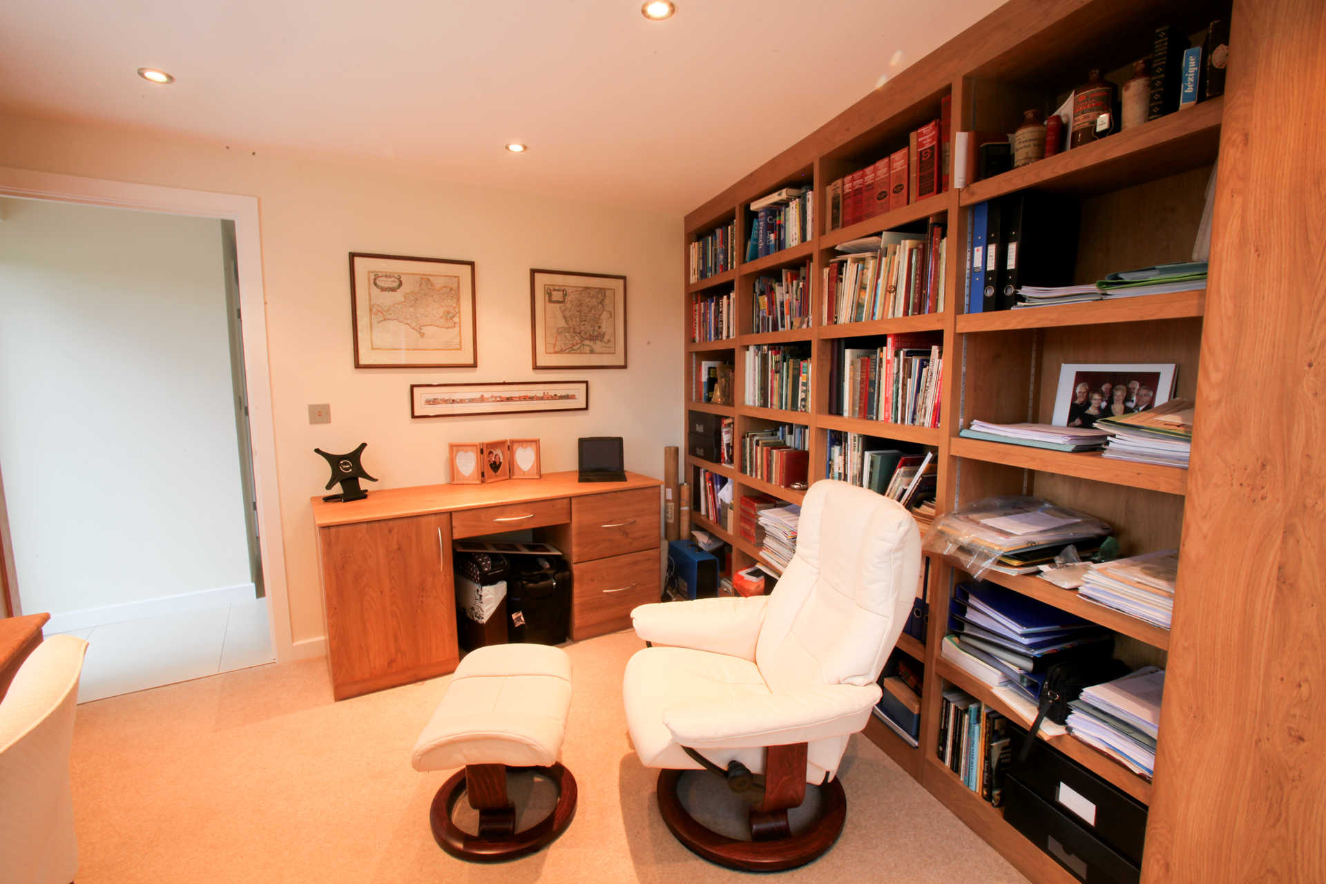 A study with a bookcase and desk